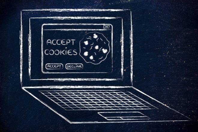 Illustration mit einem Laptop, auf dessen Bildschirm Cookies zustimmen zu lesen ist
